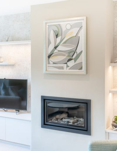 Living room renovation with art and bespoke fireplace