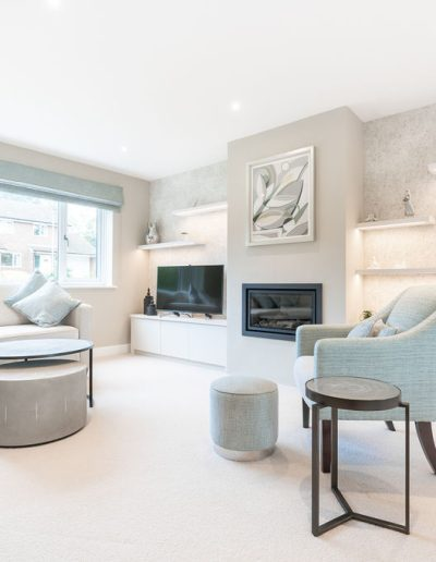 Neutral and calm living room with bespoke shelving and fireplace - Koubou Interiors