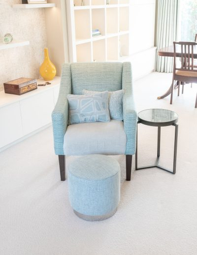 Contemporary chair and footstall designed by Koubou Interiors