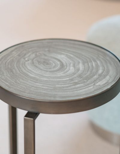 Circular end table - living room furniture designed by Koubou Interiors