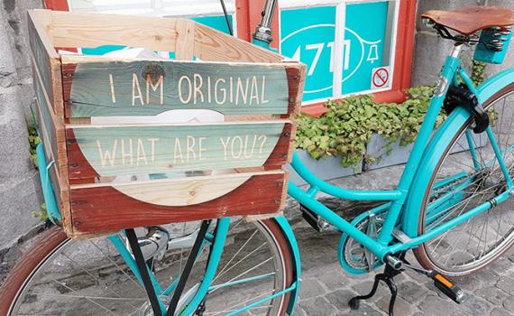 Kommunikation bild cykel låda transport turkos
