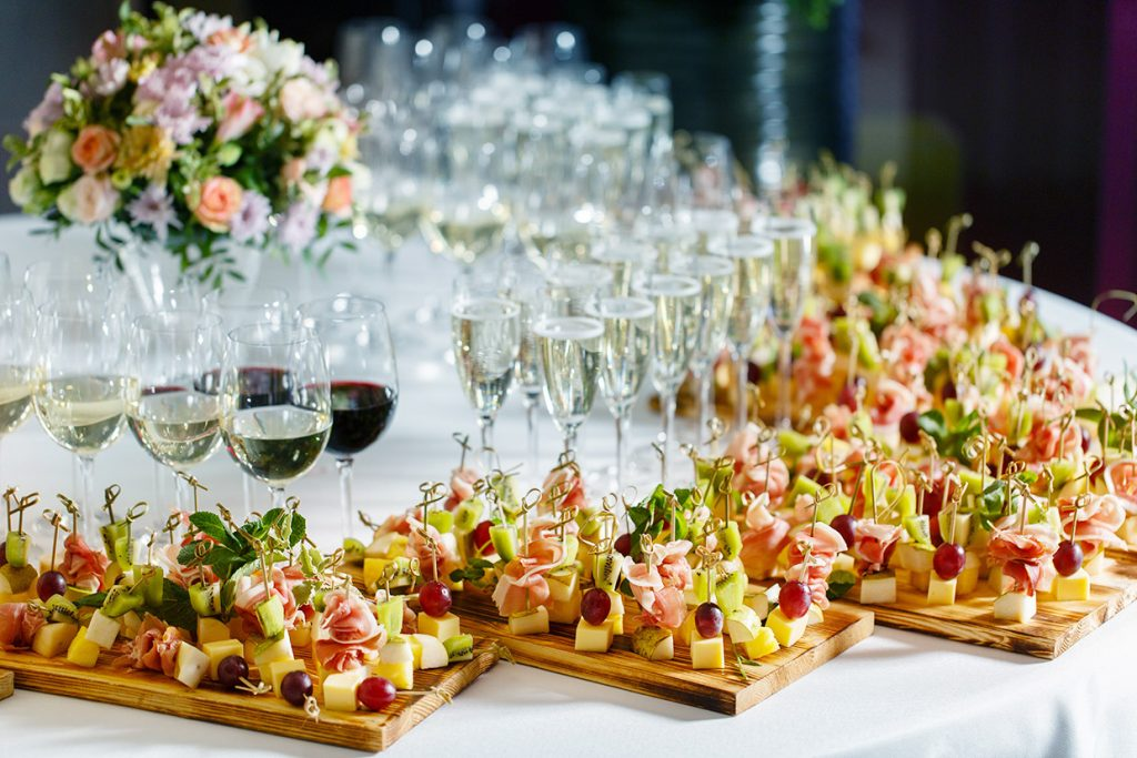 the buffet at the reception. Assortment of canapes. Banquet service. catering food, snacks with cheese, jamon, prosciutto and fruit