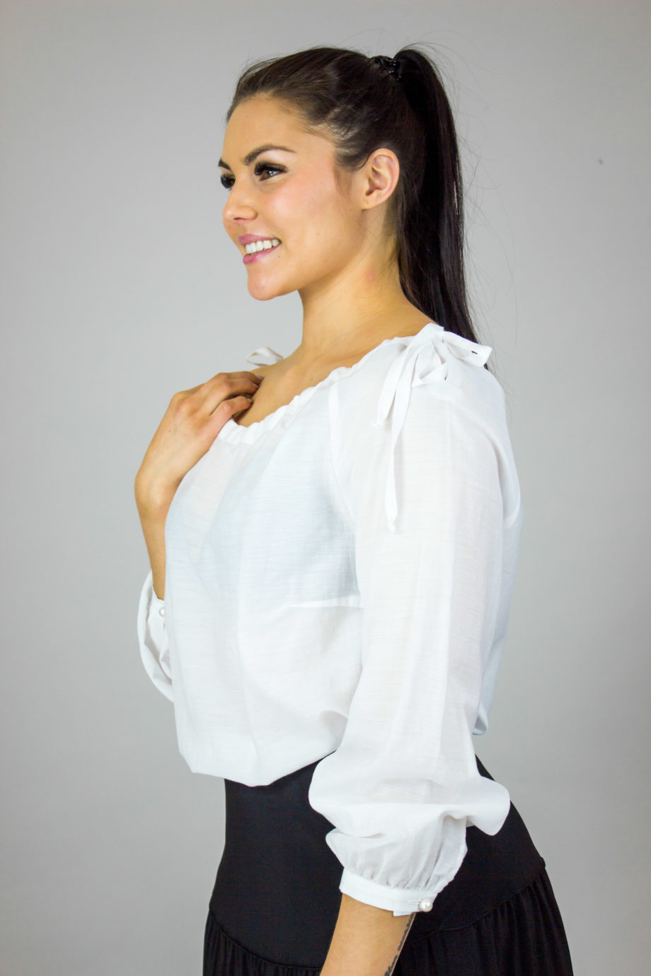 ELISE GUG Shoulder bow blouse