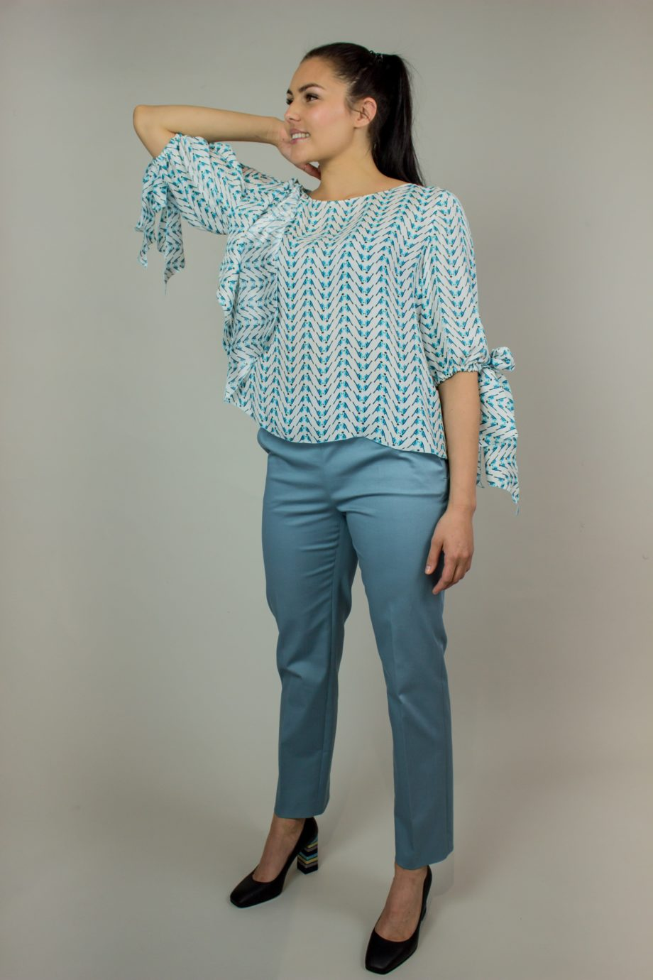 10. KRISTINA TI Turquoise silk blouse