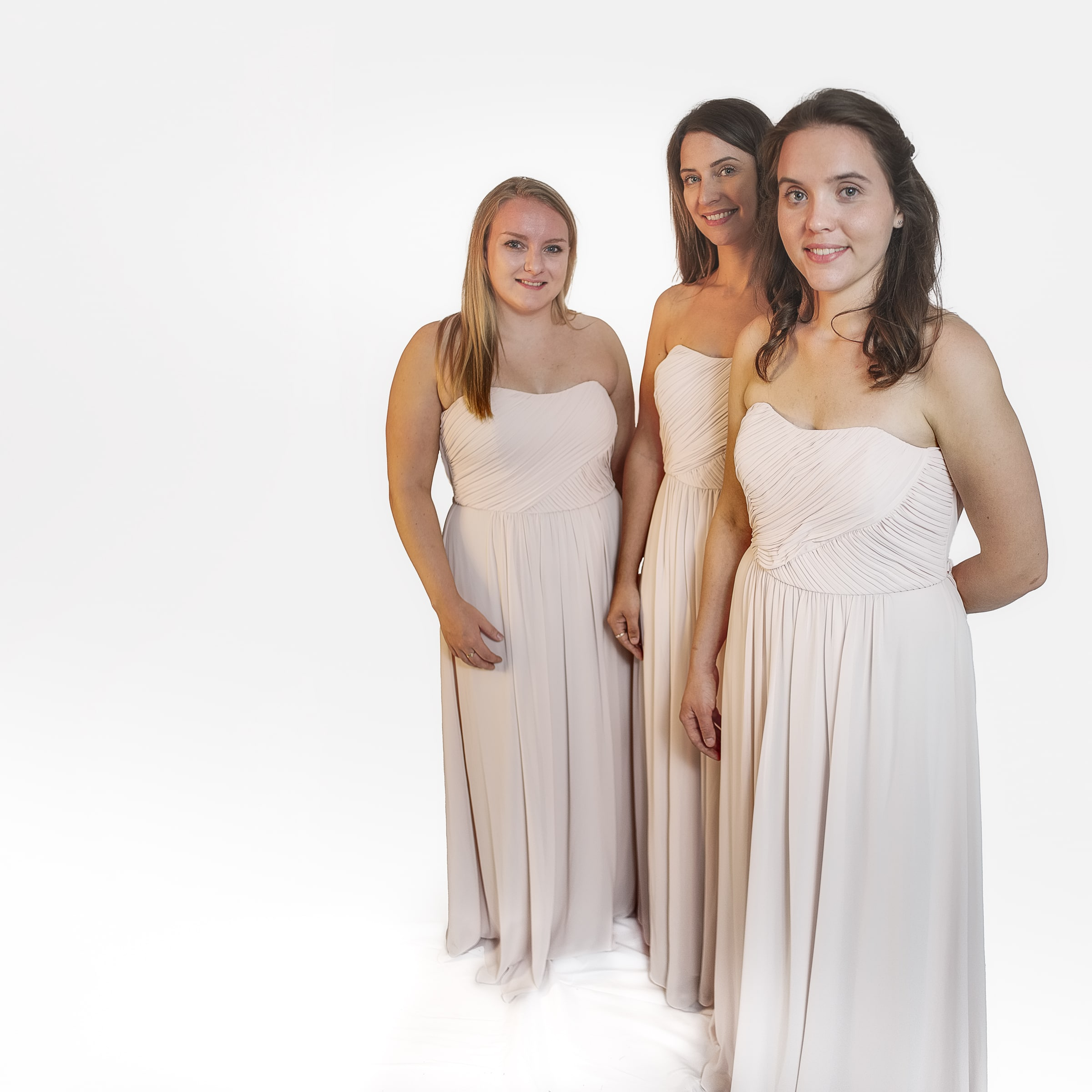 3 bridesmaids in off white dresses