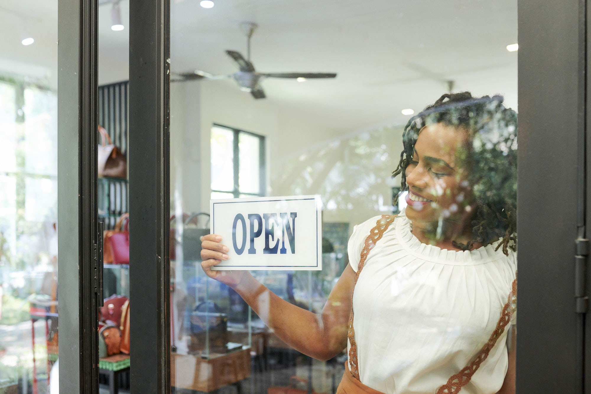 Shop assistant opening store