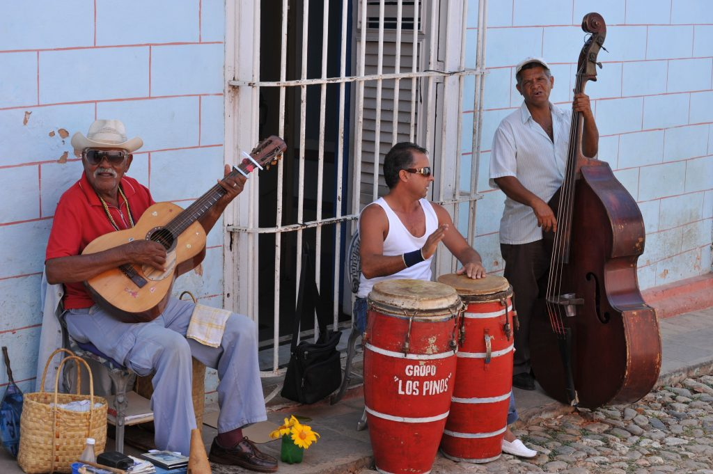 LatinA Tours Cuba Trinidad - City center, Tour, Buildings, Street, People, Musician