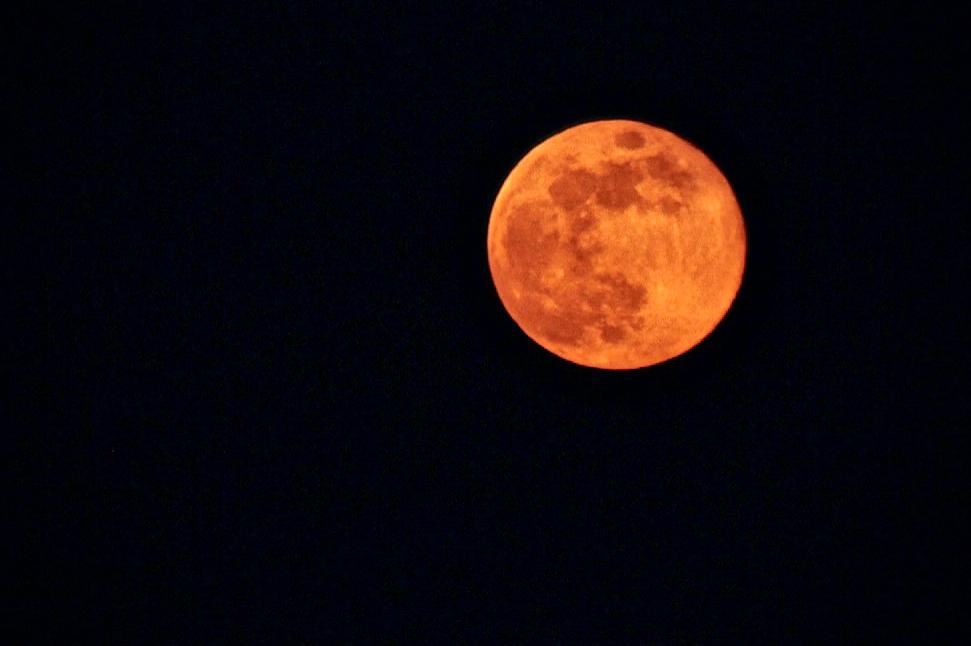 Full moon against the dark sky
