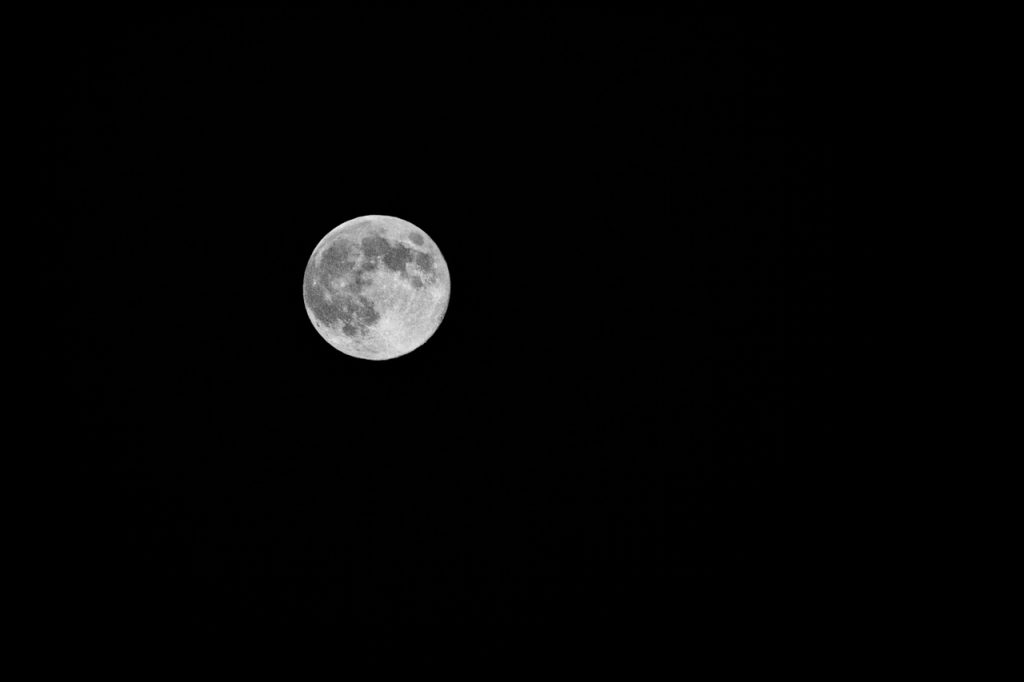 A black and white photo of the moon
