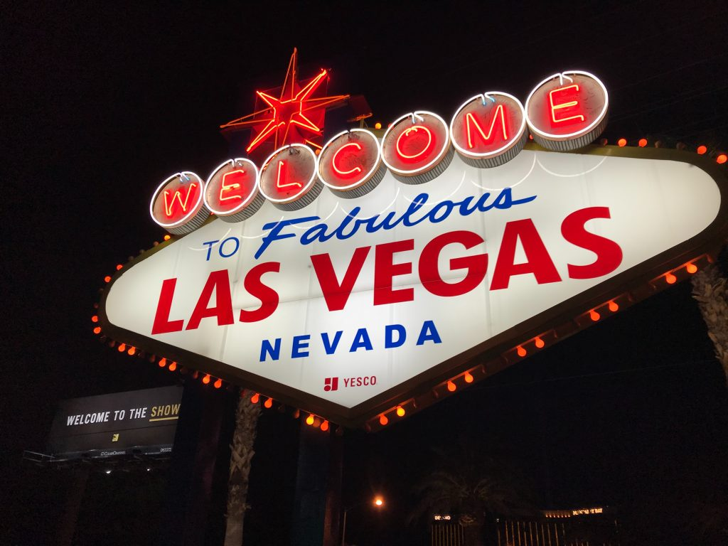 Welcome to Las Vegas Nevada-sign at night. Photo by Guido Coppa on Unsplash used to illustrate an end-of-the-world mood.