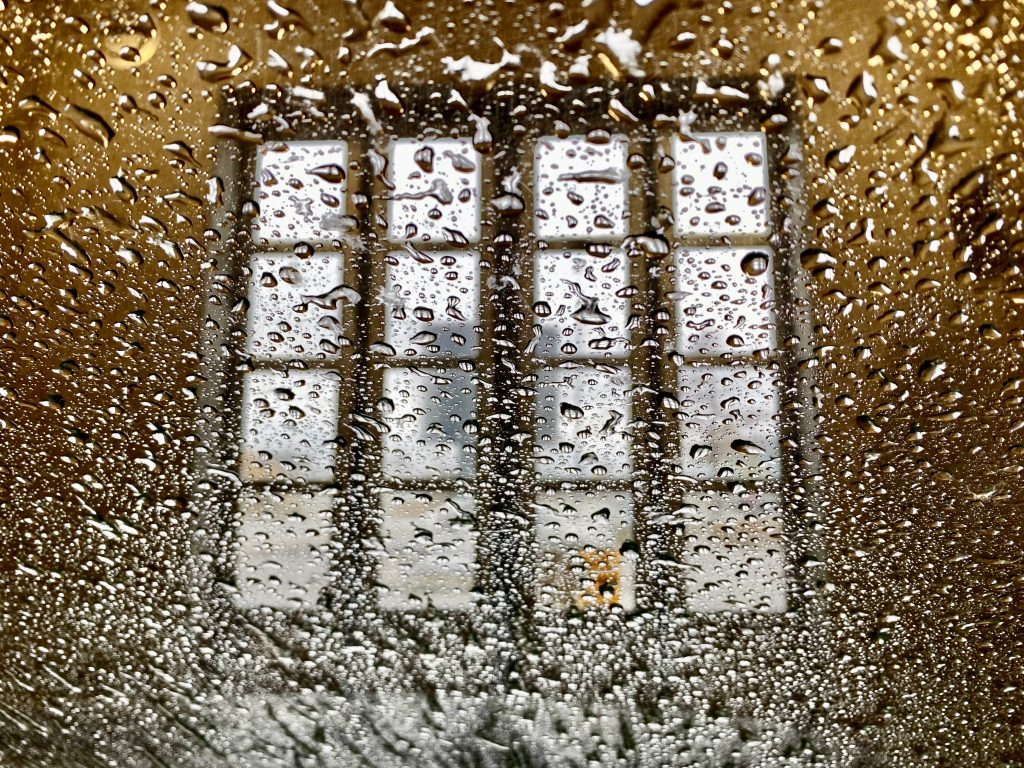 A window seen from the interior of the car when the car is in the car wash. Phone photo by Mihaela Limberea.