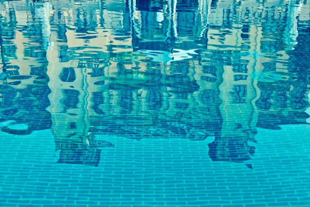 An image of the Johannesburg Palazzo Hotel reflected in the swimming pool. Photograph by Mihaela Limberea.