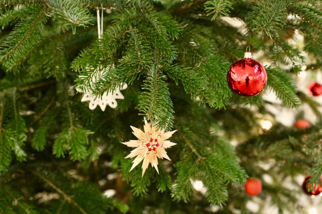 Close up of a Christmas tree with traditional Swedish straw decorations. Photo by Mihaela Limberea