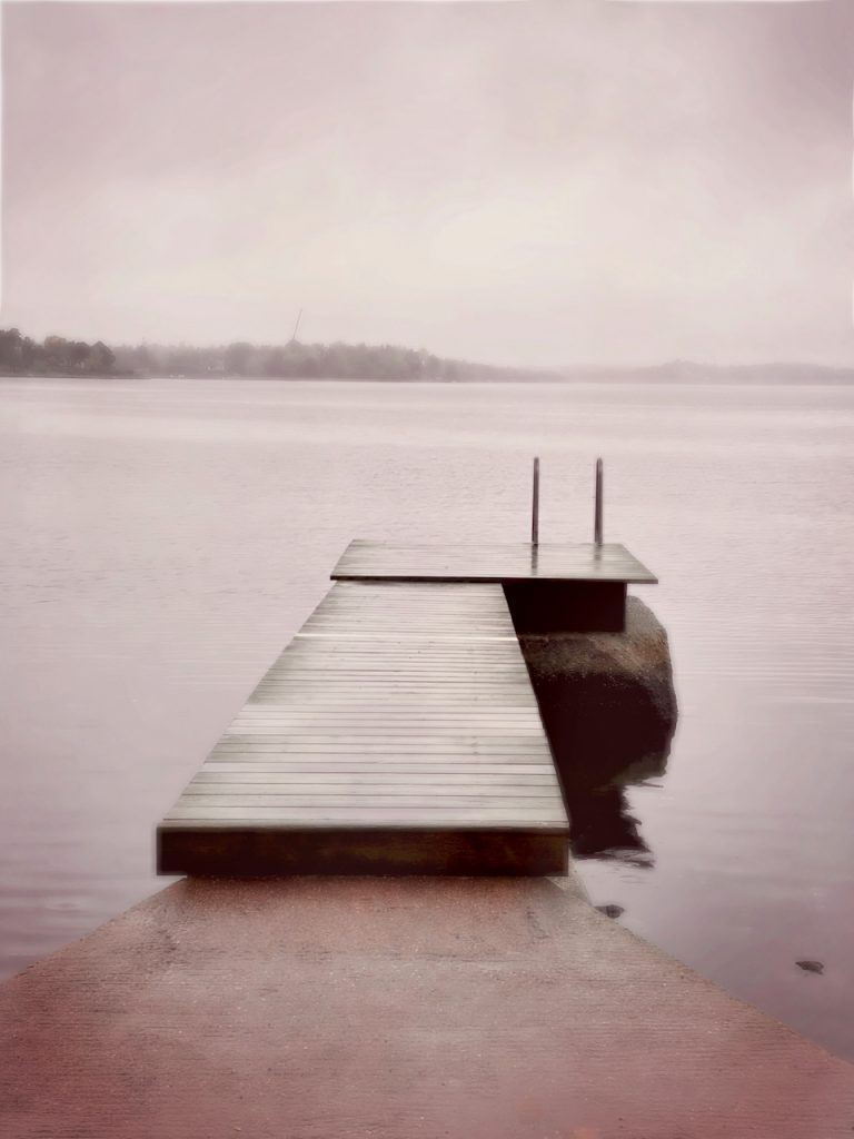 Dreamy photo of a desolated jetty. iPhone photo by Mihaela Limberea.