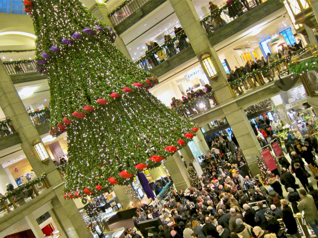 A picture of the NK department store in Stockholm, Sweden with a huge Christmas tree hanging from the ceiling. The scene depicts a book signing by author Maria Varga Llosa in 2010, the year he was awarded the Nobel Prize for literature. Photo by Mihaela Limberea.