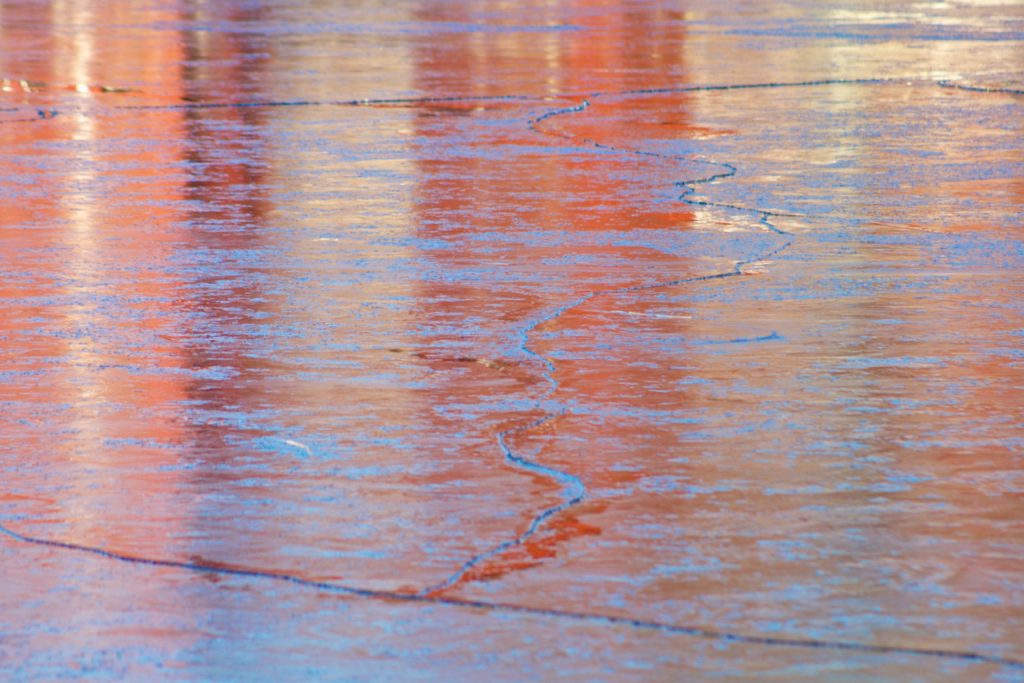 Red and blue reflections on ice. Photo by Mihaela Limberea