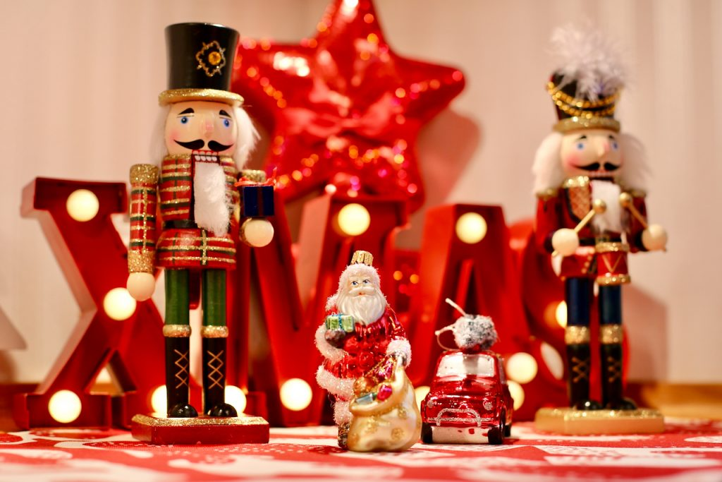 Close up of Christmas decorations, Nutcracker guards and Santa. Photo by Mihaela Limberea