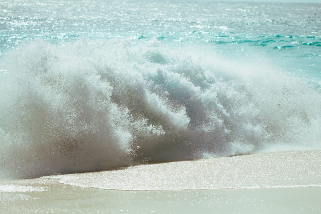 Waves crashing on the beach. Photo by Mihaela Limberea