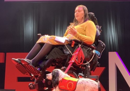 Lucy Watts MBE Speaking At A Conference