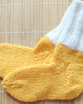 Hand knitted yellow and white socks in pure wool for babies