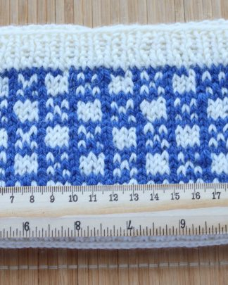 Handknitted headband in white and blue pure wool