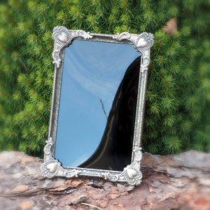 Mustat peilit