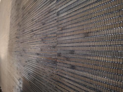 Wandfläche mit Natur- Wandverkleidung von Omexco in Lohne