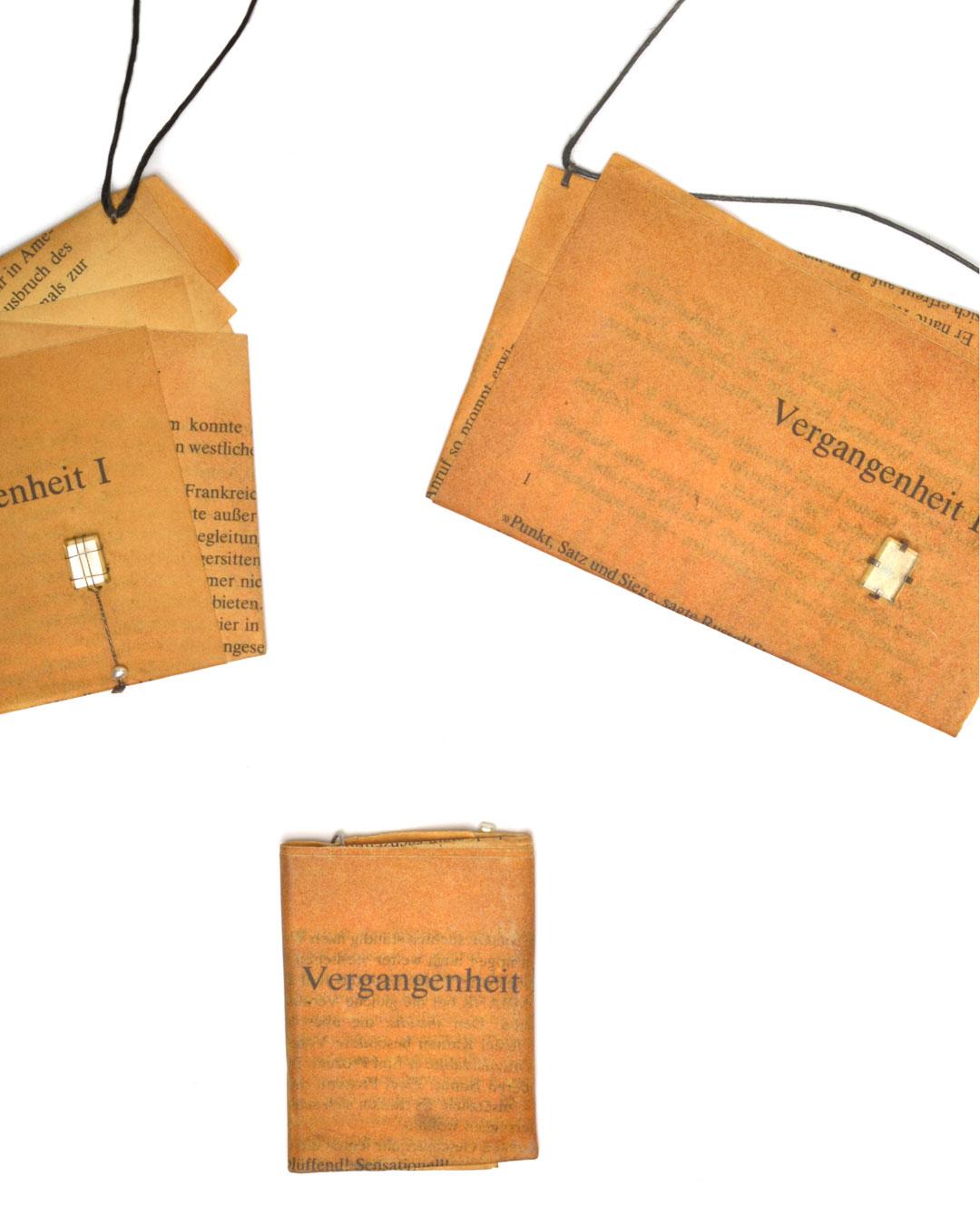 Ute Eitzenhöfer, Vergangenheiten (Pasts), 1996, two pendants and a brooch; paper, aquamarine, soft steel wire, 140 x 100 x 3 mm; 130 x 85 x 3 mm; 75 x 53 x 4 mm, €2000