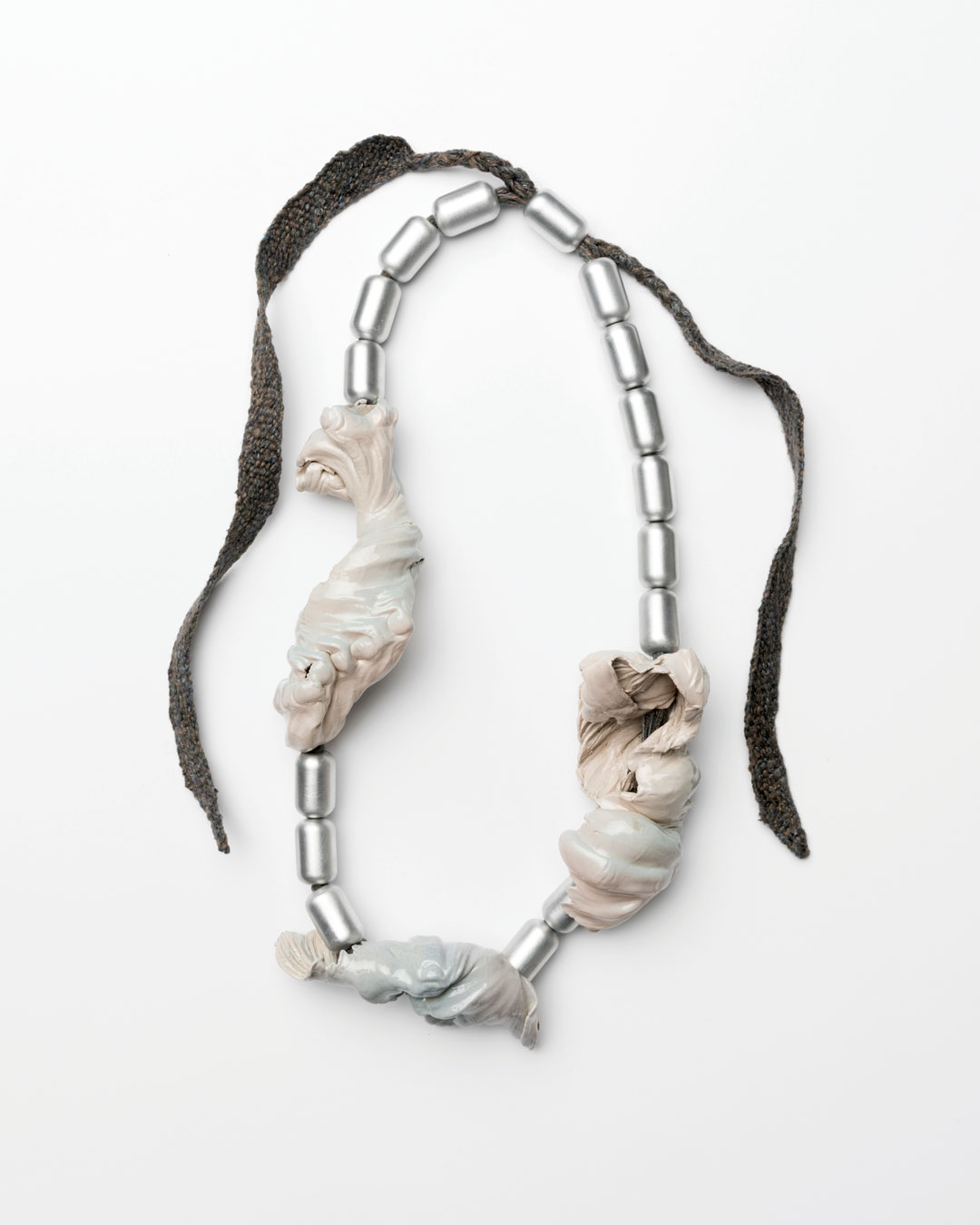 Ineke Heerkens, Cold Gravity, 2017, necklace; linen, wool, viscose, silk, aluminium, ceramic, glaze, 390 x 180 x 65 mm, €2300