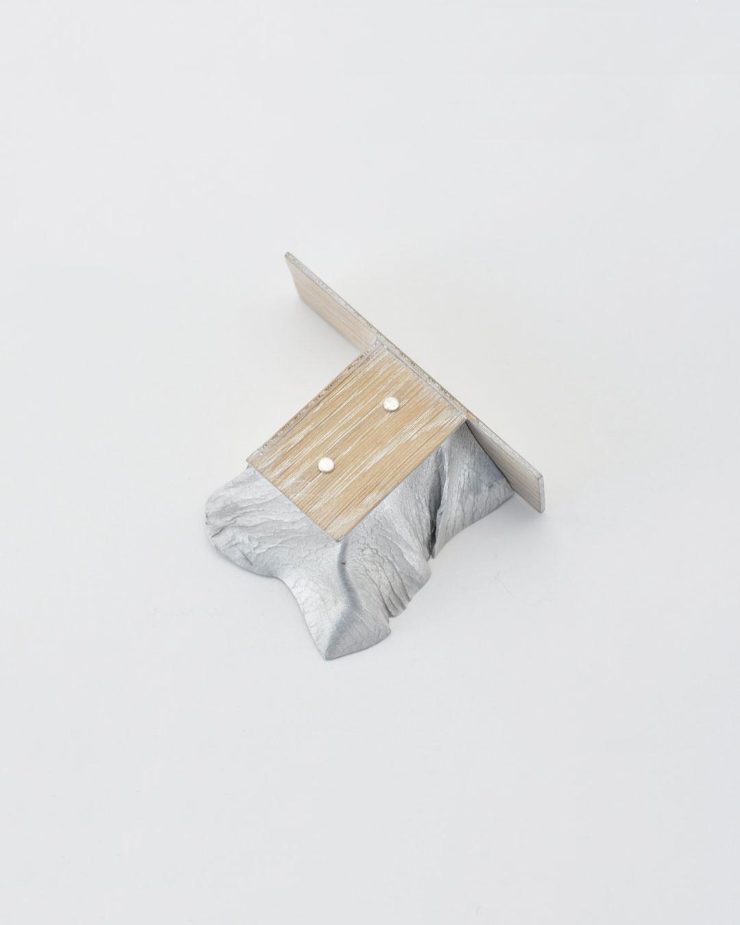 Anders Ljungberg, Declaration #4, 2019, brooch; aluminium, laminated oak, steel, 95 x 70 x 35 mm, €920