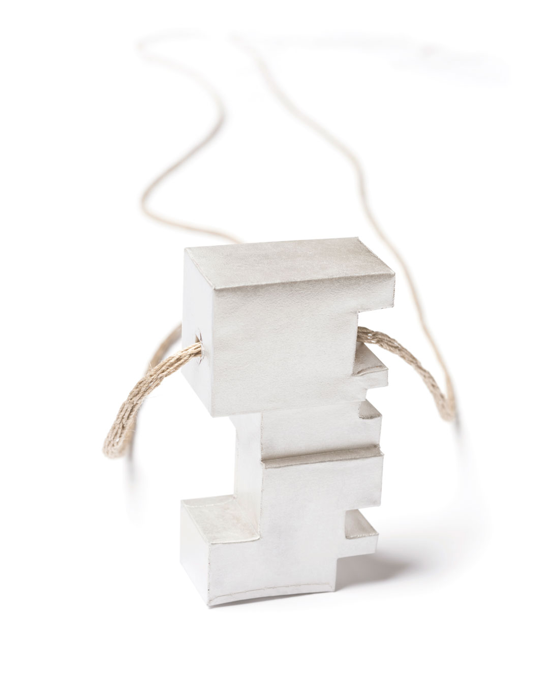 Carla Nuis, Unfurl 15, 2018, pendant; fine silver, linen, 57 x 30 x 17 mm, €710
