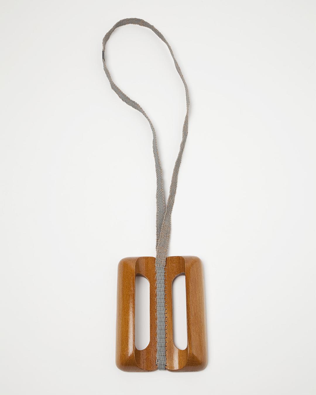 Barbara Schrobenhauser, Vom Tragen und Halten VI, 2018, necklace; used wooden handles, woven string, 470 x 90 x 20 mm, €700