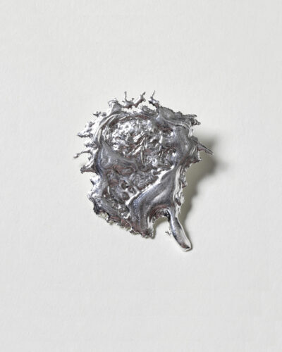 Cécile Maes, Jolis Projectils #1, 2020, brooch; melted silver (thrown on the ground or in the water) 35 x 4 mm