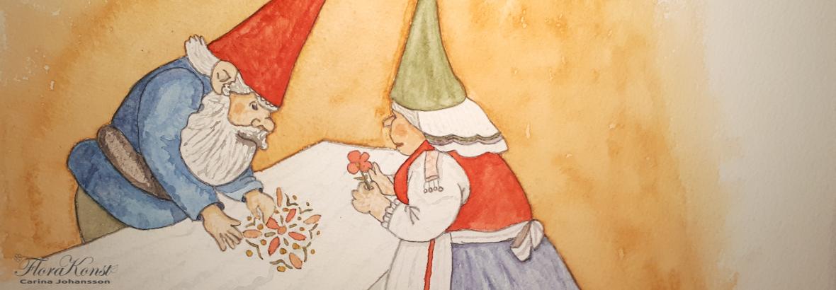 A Gnome couple making a flower mandala