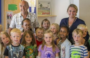 Poul-Erik Tindbaek, a School Uncle, with a class of students