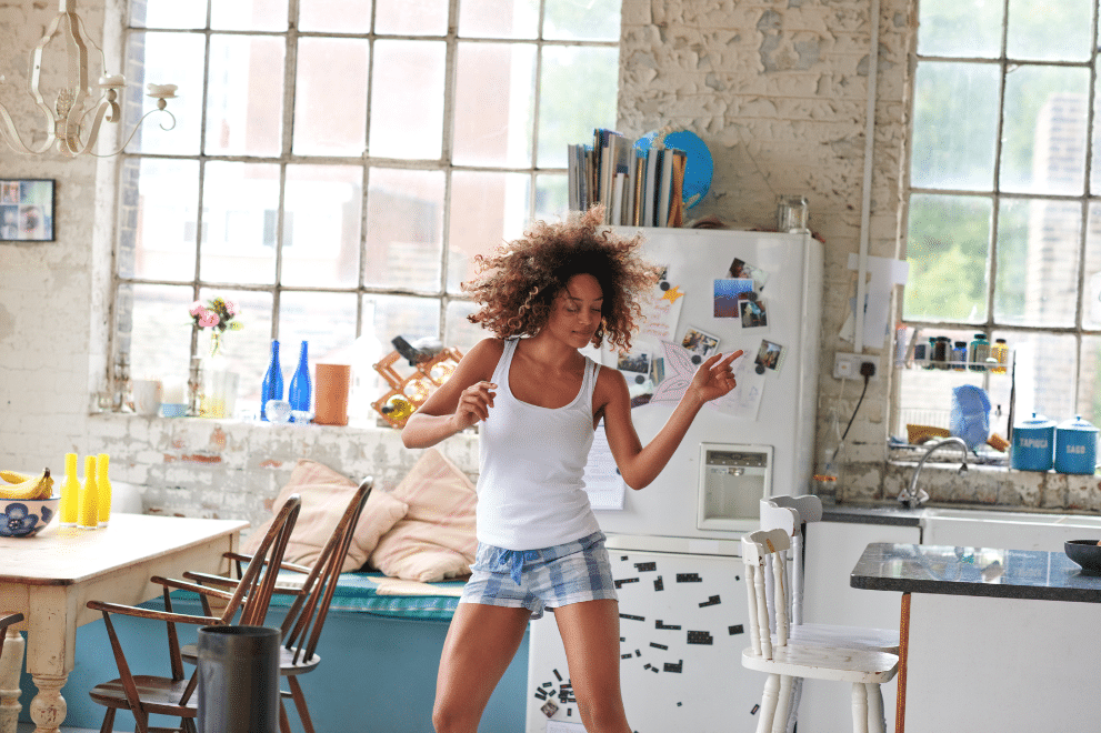 woman dancing in her kitchen