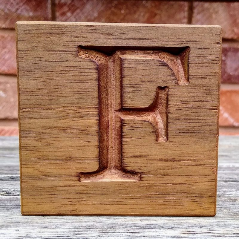 vcarve letter in walnut with stain finish using fengrave