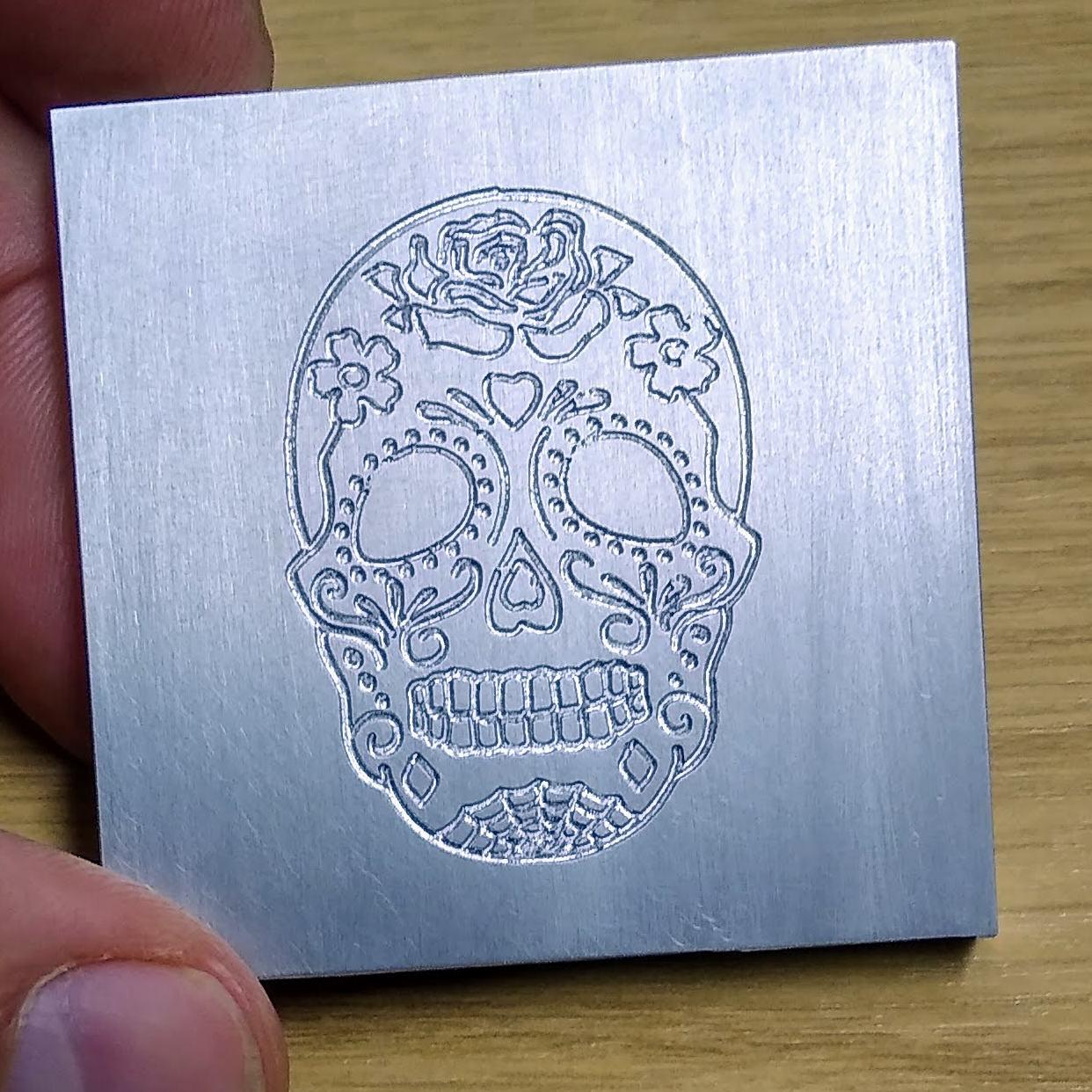 etched skull logo aluminium