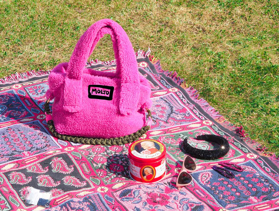 the hotfurry teddy bag in hot pink in the park chilling