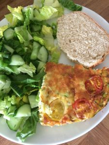 baked omelette with bread and salad