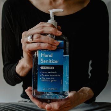 woman holding hand sanitiser