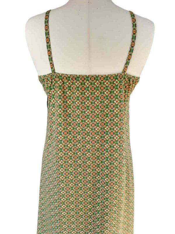 mini retro mønster i grønne og brune nuancer på bomuldsjersey, i en miss sunshine stropkjole