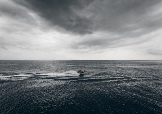 motor boat floating in sea in stormy day