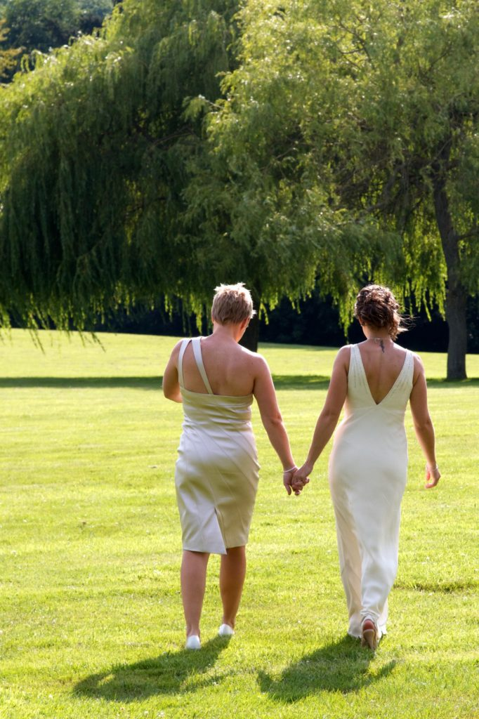Married Couple Holding Hands myohmy weddings