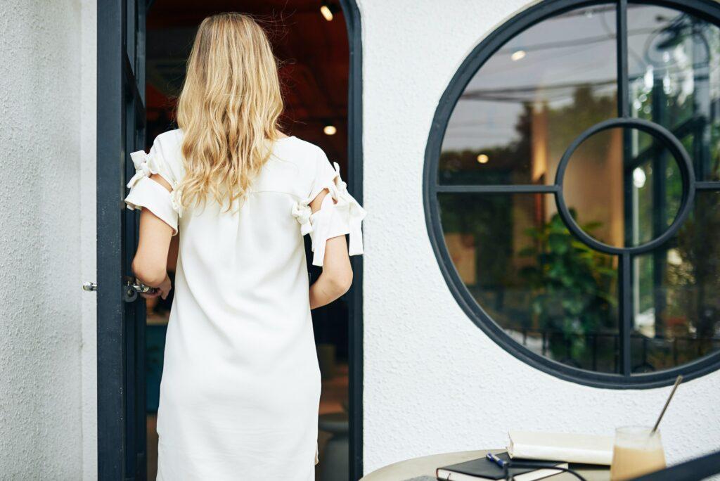 Woman entering cafe door