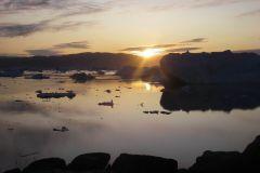 Ammassalik.-Solnedgang-ved-isfjorden