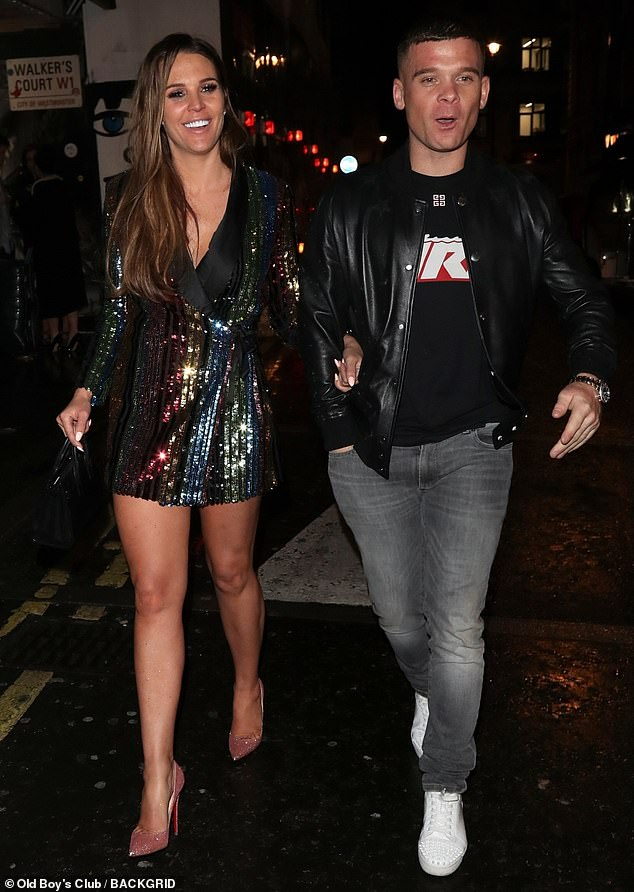 Loved up:Danielle Lloyd, 34, didn't disappoint as she enjoyed a night out with her fiance Michael O'Neill at The Box in London, on Saturday