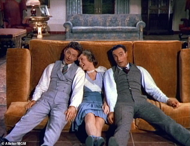 The early movie days: Debbie with Cosmo Brown, left, and Gene Kelly, right, in the 1952 film Singin' In The Rain