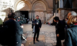 Matteo Salvini takes a selfie at the end of a visit to the Church of the Holy Sepulchre in Jerusalem