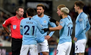 Manchester City's players voice their displeasure to Paul Tierney after he chalked off their goal and booked Kevin De Bruyne.